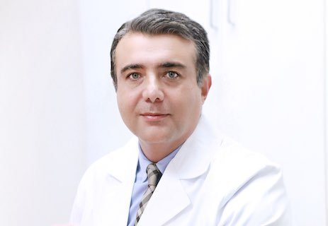 Dr. Kooshyar Tahmasbi, D.D.S.